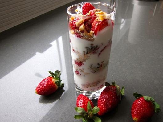 Yogourt, berries, flax seeds, hemp seeds, chia seeds, cacao nibs, coconut flakes